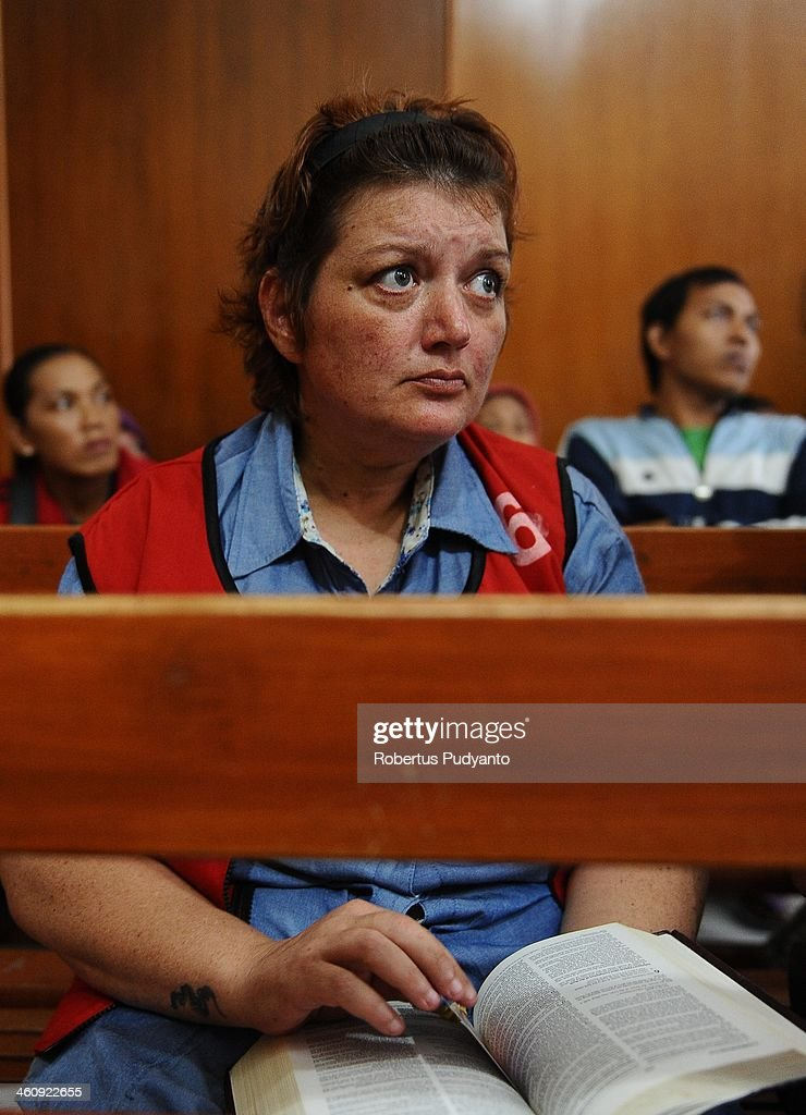 Andrea Waldeck of Britian (43) waits in court at a hearing for drug trafficking charges on January 6, 2014 in Surabaya, Indonesia. Prosecutors are seeking a 16-year prison term and a fine of around £100,000 for Andrea Waldeck, who has admitted trafficking crystal meth into the country from China and previously faced the possibility of a death sentence. The former PCSO with Gloucestershire Police had pleaded guilty to the offence after being arrested in April in possession of 3lb of methamphetamine crystals hidden in her underwear.