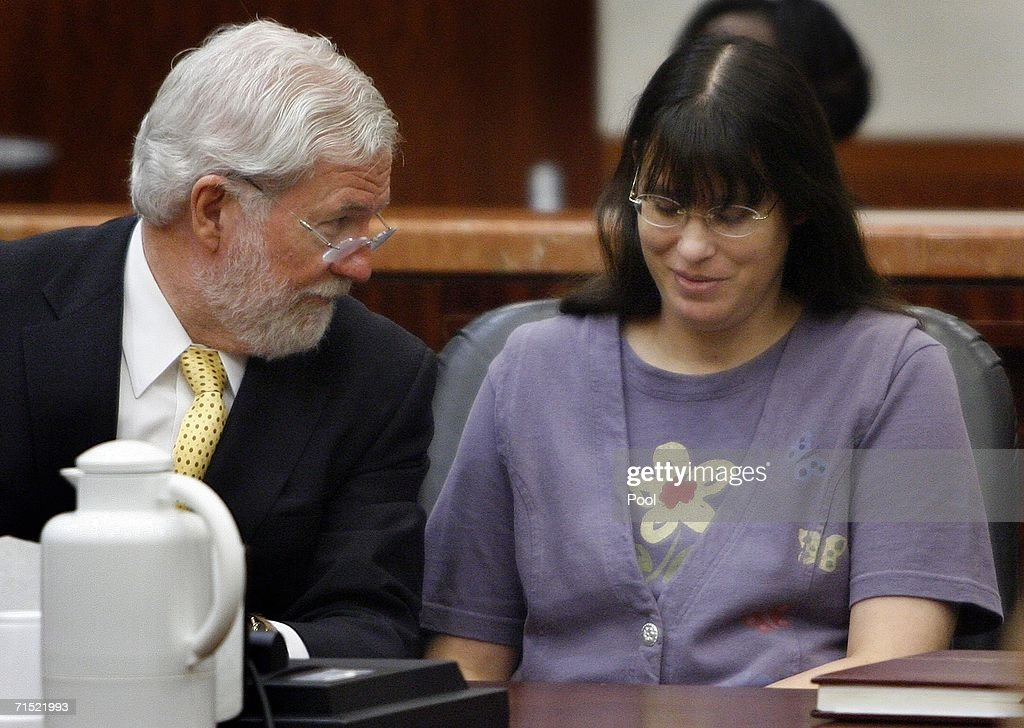Andrea Yates (R) smiles with her attorney George Parnham as they await the verdict in her retrial July 26, 2006 in Houston. Yates admits to drowning her five children in a bath tub in 2001 and plead guilty by reason of insanity.