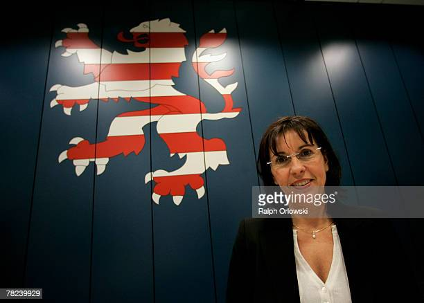 Andrea Ypsilanti German Social Democrats gubernatorial candidate in the German state of Hesse stands in front of the Hesse Lion the heraldic animal...