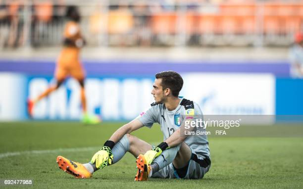 Andrea Zaccagno of Italy sits dejected on the pitch during the FIFA U20 World Cup Korea Republic 2017 Quarter Final match between Italy and Zambia at...