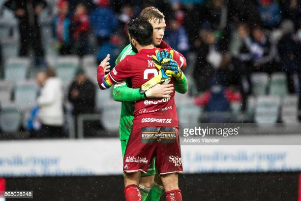 Andreas Andersson goalkeeper of Ostersunds FK and Brwa Nouri of Ostersunds FK celebrates after the victory in the Allsvenskan match between IFK...
