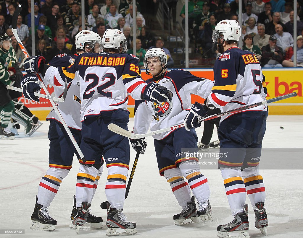 Andreas Athanasiou #22 of the Barrie Colts celebrates his goal with teammates in Game One of the OHL Championship Final against the London Knights on May 3, 2013 at the Budweiser Gardens in London, Ontario, Canada. The Colts defeated the Knights 4-2 to take a 1-0 series lead.