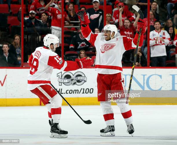 Andreas Athanasiou of the Detroit Red Wings celebrates his gamewinning goal against the Carolina Hurricanes with teammate Robbie Russo during...