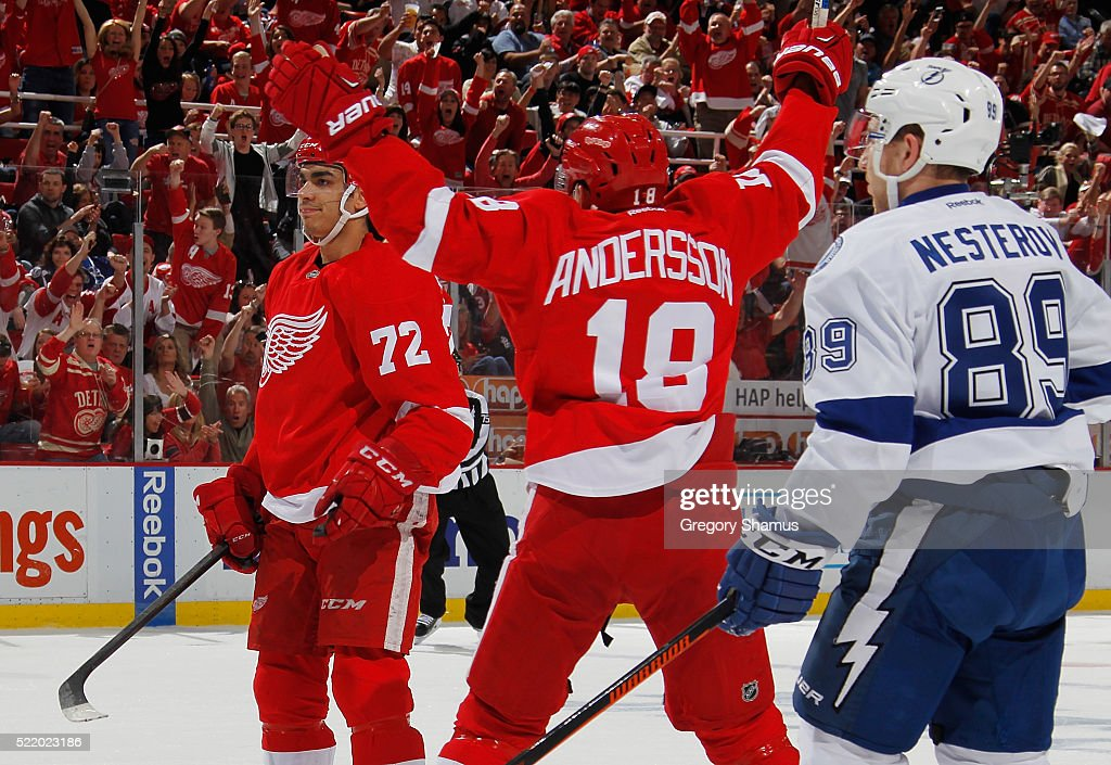 Andreas Athanasiou of the Detroit Red Wings celebrates his second period goal with Joakim Andersson while playing the Tampa Bay Lightning in Game...