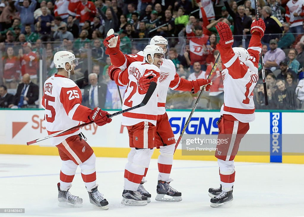 Andreas Athanasiou #72 of the Detroit Red Wings celebrates with Mike Green #25 of the Detroit Red Wings, Jonathan Ericsson #52 of the Detroit Red Wings and Gustav Nyquist #14 of the Detroit Red Wings after scoring against the Dallas Stars in the second period at American Airlines Center on February 29, 2016 in Dallas, Texas.