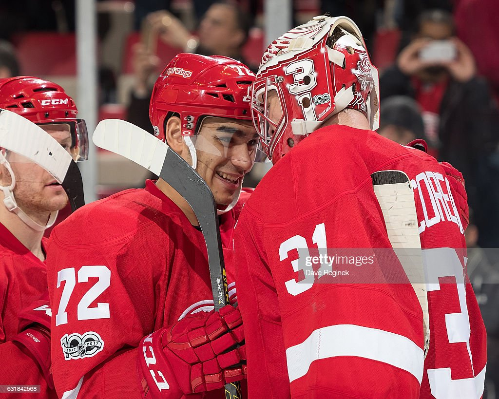 Andreas Athanasiou #72 of the Detroit Red Wings congratulates teammate goaltender Jared Coreau #31 on his shutout following an NHL game against the Montreal Canadiens at Joe Louis Arena on January 16, 2017 in Detroit, Michigan. The Wings defeated the Canadiens 1-0.