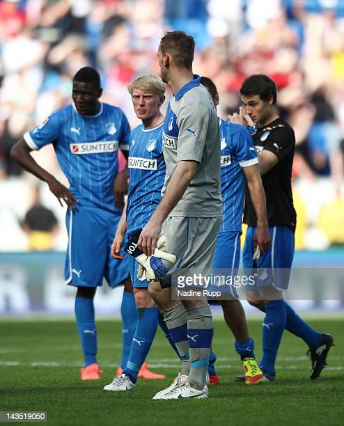 Andreas Beck and goalkeeper Tom Starke of Hoffenheim look dejected after loosing the Bundesliga match between 1899 Hoffenheim and 1 FC Nuernberg at...