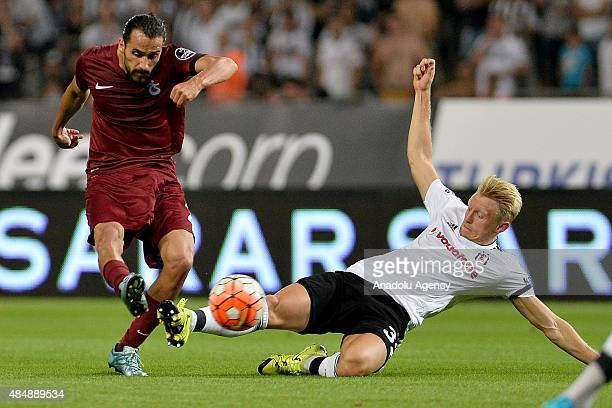 Andreas Beck of Besiktas vies for the ball with Erkan Zengin of Trabzonspor during the Turkish Spor Toto Super League football match between Besiktas...