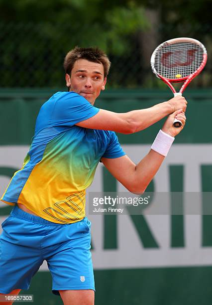 Andreas Beck of Germany plays a backhand during his Men's Single Match against Fabio Fognini of Italy during day two of the French Open at Roland...