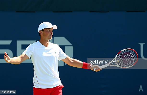 Andreas Beck of Germany reacts against Pablo Carreno Busta of Spain during his men's singles first round match on Day One of the 2014 US Open at the...