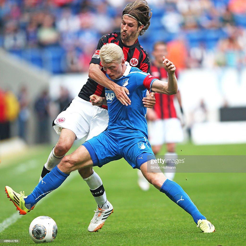 Andreas Beck of Hoffenheim is challenged by Martin Lanig of Frankfurt during the Bundesliga match between 1899 Hoffenheim and Eintracht Frankfurt at wirsol Rhein-Neckar Arena on April 26, 2014 in Sinsheim, Germany.