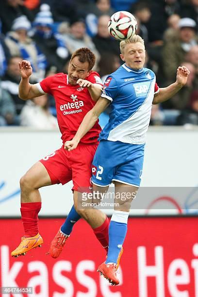 Andreas Beck of Hoffenheim jumps for a header with Shinji Okazaki of Mainz during the Bundesliga match between 1899 Hoffenheim and 1 FSV Mainz 05 at...