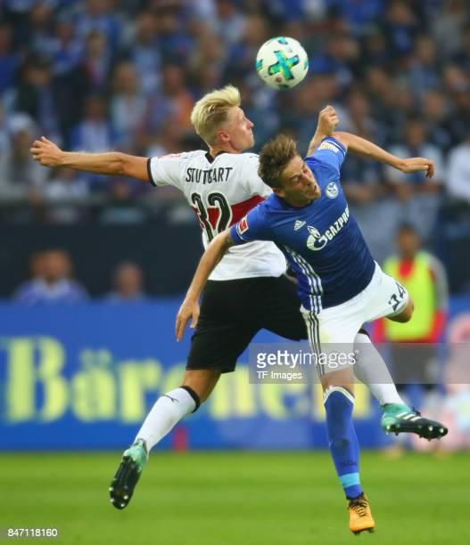 Andreas Beck of Stuttgart and Bastian Oczipka of Schalke battle for the ball during the Bundesliga match between FC Schalke 04 and VfB Stuttgart at...