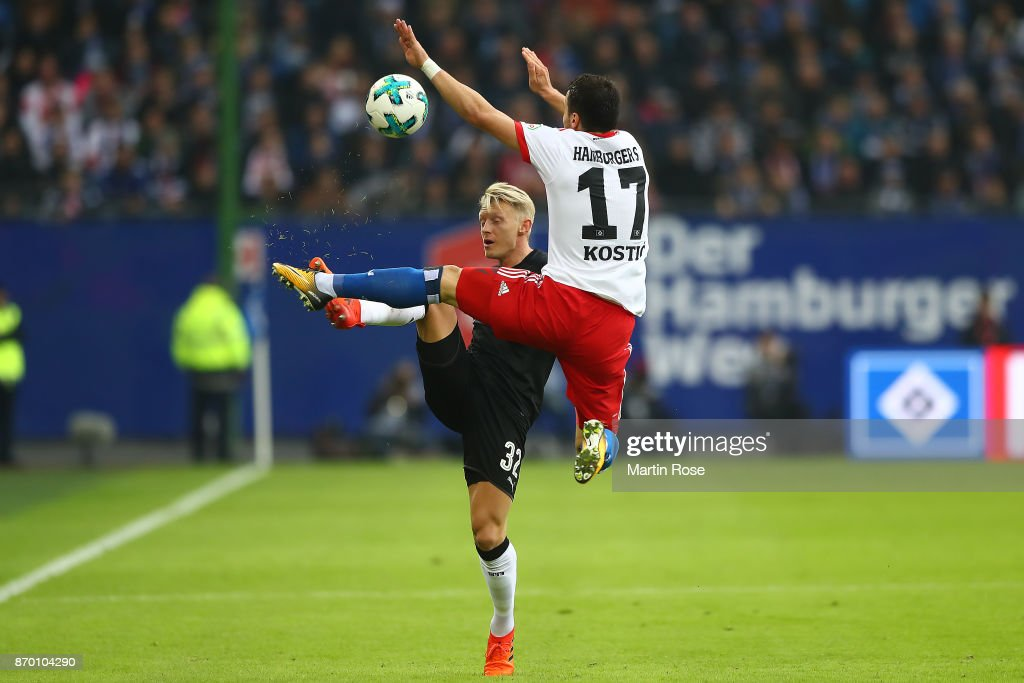 Andreas Beck of Stuttgart (l) fights for the ball with Filip Kostic of Hamburg during the Bundesliga match between Hamburger SV and VfB Stuttgart at Volksparkstadion on November 4, 2017 in Hamburg, Germany.