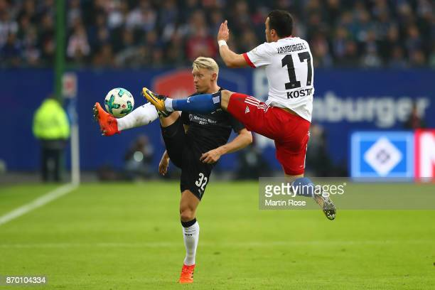 Andreas Beck of Stuttgart fights for the ball with Filip Kostic of Hamburg during the Bundesliga match between Hamburger SV and VfB Stuttgart at...