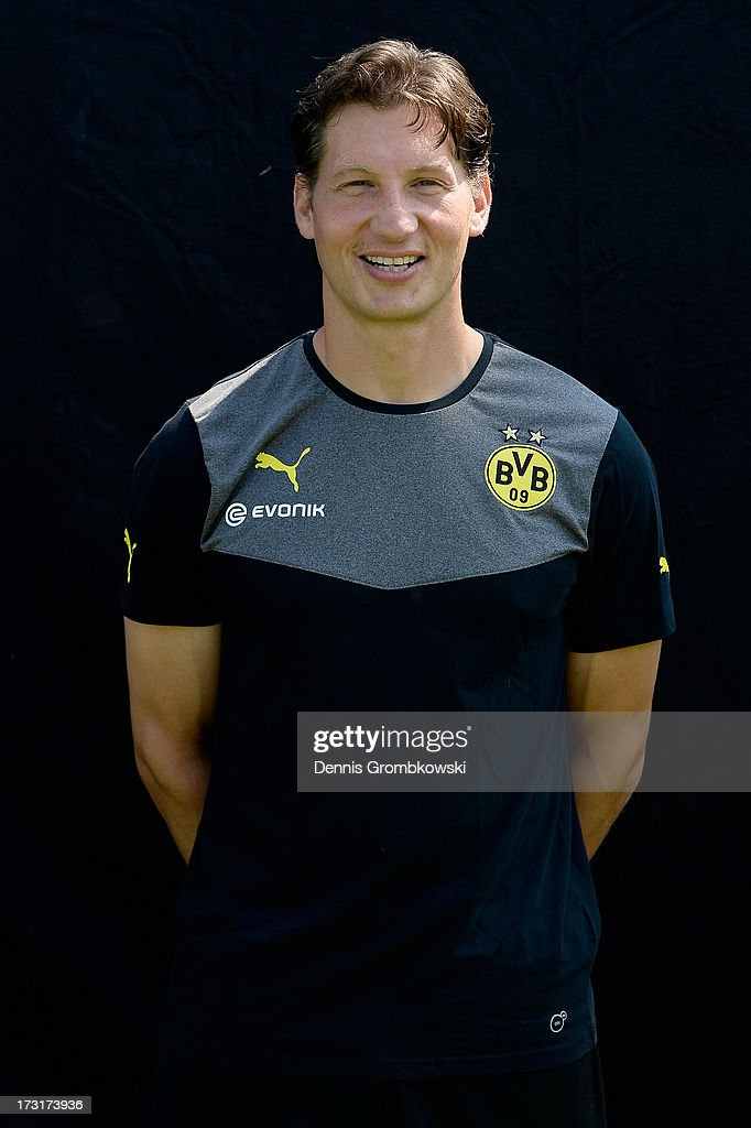 <a gi-track='captionPersonalityLinkClicked' href=/galleries/search?phrase=Andreas+Beck&family=editorial&specificpeople=635198 ng-click='$event.stopPropagation()'>Andreas Beck</a> poses during the Borussia Dortmund Team Presentation at Brackel Training Ground on July 9, 2013 in Dortmund, Germany.
