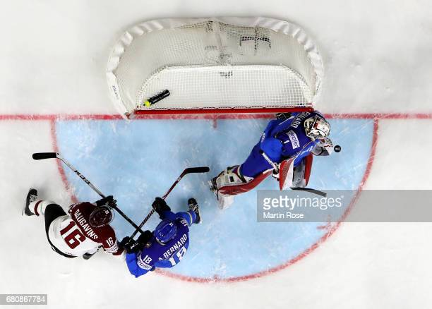 Andreas Bernard goaltender of Italy makes a save during the 2017 IIHF Ice Hockey World Championship game between Italy and Latvia at Lanxess Arena on...