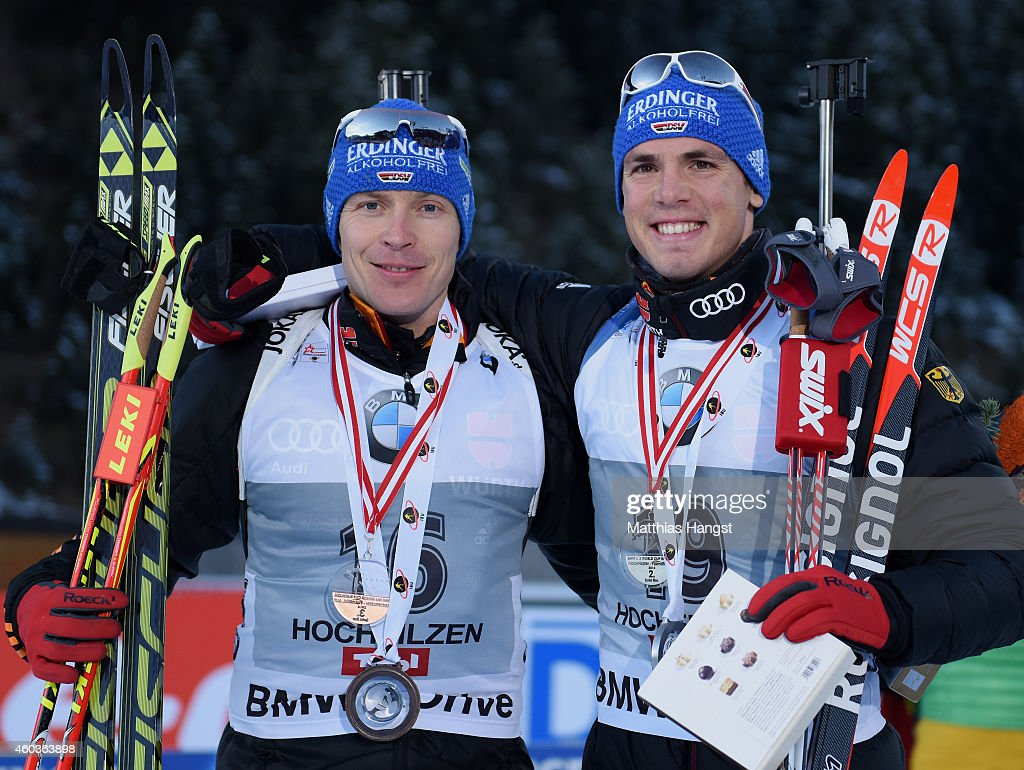 Andreas Birnbacher of Germany and Simon Schmepp of Germany celebrate after the podium of the men's 10 km sprint event during the IBU Biathlon World...