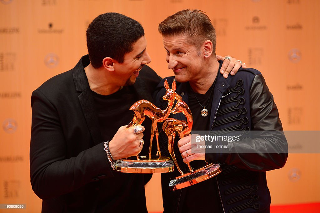 Andreas Bourani (L) and Hartmut Engler are seen with their awards at the Bambi Awards 2015 winners board at Stage Theater on November 12, 2015 in Berlin, Germany.