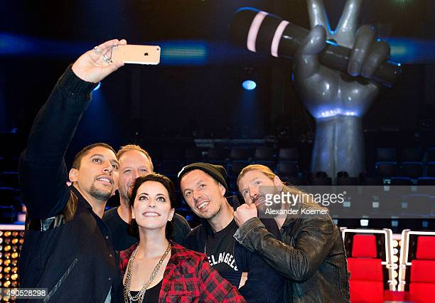 Andreas Bourani Smudo Stefanie Kloss Michi Beck and Rea Garvey take a selfie during a photo call for the television talent show 'The Voice of...