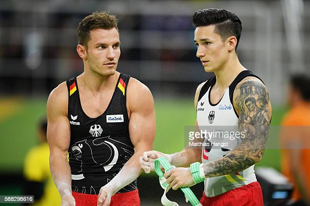 Andreas Bretschneider and Marcel Nguyen of Germany talk during the Men's Individual AllAround final on Day 5 of the Rio 2016 Olympic Games at the Rio...