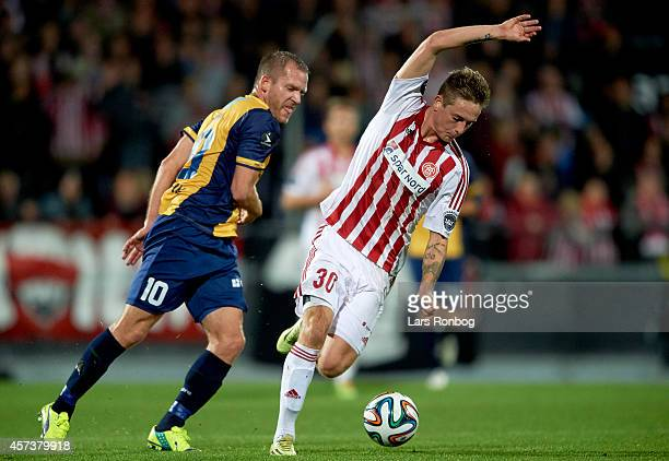 Andreas Bruhn of AaB Aalborg and Martin Thomsen of Hobro IK compete for the ball during the Danish Superliga match between AaB Aalborg and Hobro IK...
