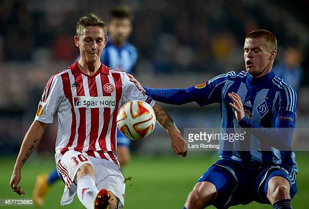 Andreas Bruhn of AaB Aalborg and Mykyta Burda of Dynamo Kyiv compete for the ball during the UEFA Europa League match between AaB Aalborg and Dynamo...