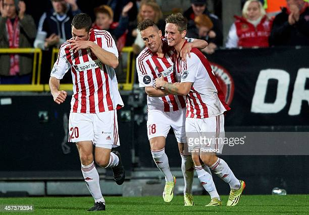 Andreas Bruhn of AaB Aalborg celebrates with team mate Anders K Jacobsen after scoring their first goal during the Danish Superliga match between AaB...