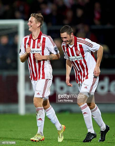 Andreas Bruhn of AaB Aalborg celebrates with team mate Henrik Dalsgaard after scoring their first goal during the Danish Superliga match between AaB...