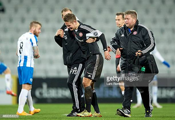 Andreas Bruhn of AaB Aalborg is injured leaves the pitch during the Danish Superliga match between OB Odense and AaB Aalborg at Trefor Park on...