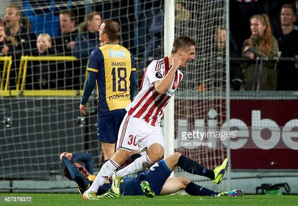 Andreas Bruhn of AaB Aalborg scores the 11 goal against Goalkeeper Jesper Rask of Hobro IK during the Danish Superliga match between AaB Aalborg and...