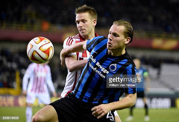Andreas Bruhn of Aalborg BK and Vormer Rudy Ruud of Club Brugge pictured during UEFA Europa League round of 32 second leg match match between Club...