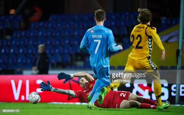 Andreas Bruhn of Randers FC and Goalkeeper Steve Clark of AC Horsens compete for the ball during the Danish Alka Superliga match between Randers FC...