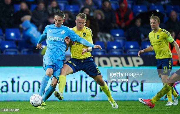 Andreas Bruhn of Randers FC and Hjortur Hermannsson of Brondby IF compete for the ball during the Danish Cup DBU Pokalen quarterfinal match between...