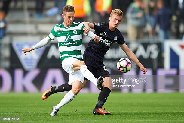 Andreas Bruhn of Viborg FF and Mikkel Kallesoe of Randers FC compete for the ball during the Danish Alka Superliga match between Viborg FF and...