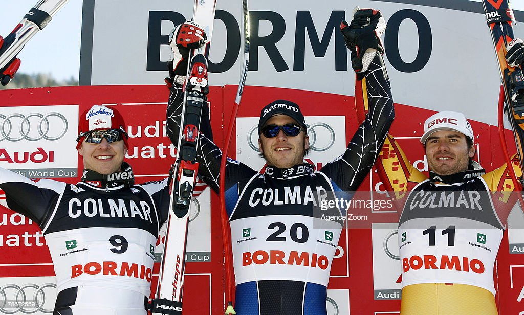 Andreas Buder of Austria, 2nd place, Bode Miller of the USA, 1st place, Jan Hudec of Canada, 3rd place, celebrate onthe podium after the Alpine FIS Ski World Cup Men's Downhill on December 29, 2007 in Bormio, Italy.