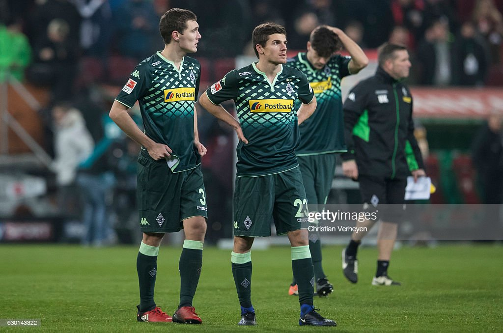 Andreas Christensen and Jonas Hofmann of Borussia Moenchengladbach react after the Bundesliga match between FC Augsburg and Borussia Moenchengladbach at WWK-Arena on December 17, 2016 in Augsburg, Germany.