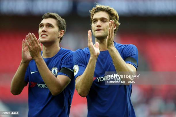 Andreas Christensen and Marcos Alonso of Chelsea applaud after the Premier League match between Tottenham Hotspur and Chelsea at Wembley Stadium on...