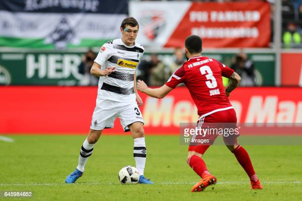 Andreas Christensen of Borussia Moenchengladbach and Anthony Jung of Ingolstadt battle for the ball during the Bundesliga match between FC Ingolstadt...