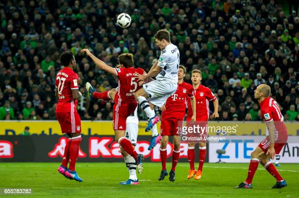 Andreas Christensen of Borussia Moenchengladbach and Mats Hummels of FC Bayern Muenchen battle for the ball during the Bundesliga Match between...