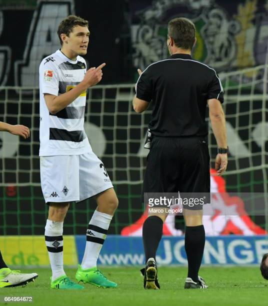 Andreas Christensen of Borussia Moenchengladbach and referee Guenter Perl during the Bundesliga match between Borussia Moenchengladbach and Hertha...
