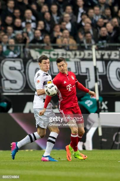 Andreas Christensen of Borussia Moenchengladbach and Robert Lewandowski of FC Bayern Muenchen battle for the ball during the Bundesliga Match between...