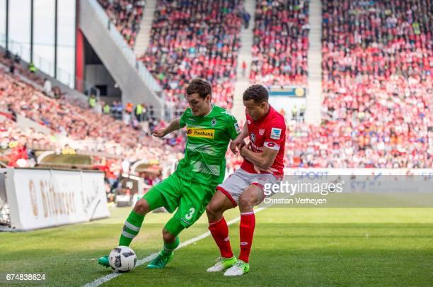 Andreas Christensen of Borussia Moenchengladbach and Robin Quaison of FSV Mainz 05 battle for the ball during the Bundesliga Match between 1FSV Mainz...