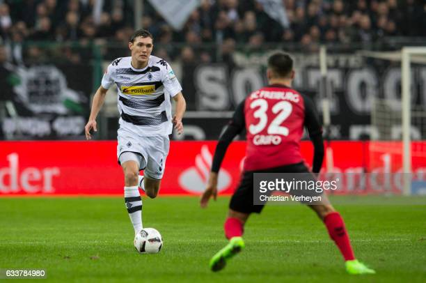 Andreas Christensen of Borussia Moenchengladbach and Vincenzo Grifo of SC Freiburg during the Bundesliga Match between Borussia Moenchengladbach and...