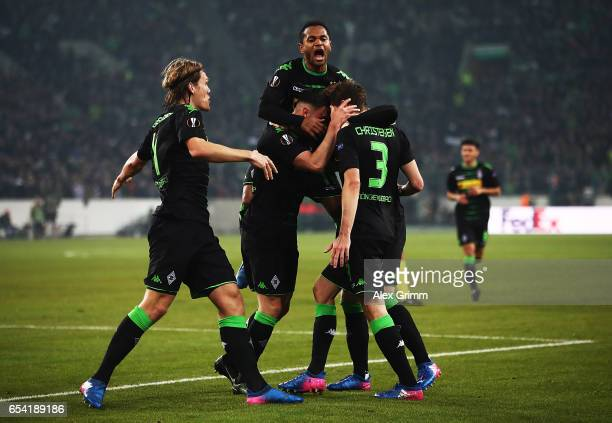 Andreas Christensen of Borussia Moenchengladbach celebrates with Oscar Wendt and Raffael after scoring a goal during the UEFA Europa League Round of...