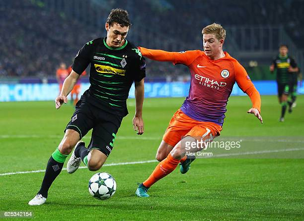 Andreas Christensen of Borussia Moenchengladbach is challenged by Kevin De Bruyne of Manchester Cityduring the UEFA Champions League match between...