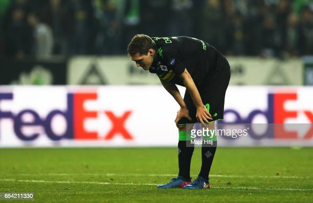 Andreas Christensen of Borussia Moenchengladbach is dejected after the UEFA Europa League Round of 16 second leg match between Borussia...