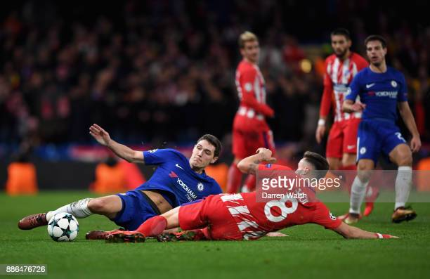 Andreas Christensen of Chelsea and Saul Niguez of Atletico Madrid challenge for the ball during the UEFA Champions League group C match between...