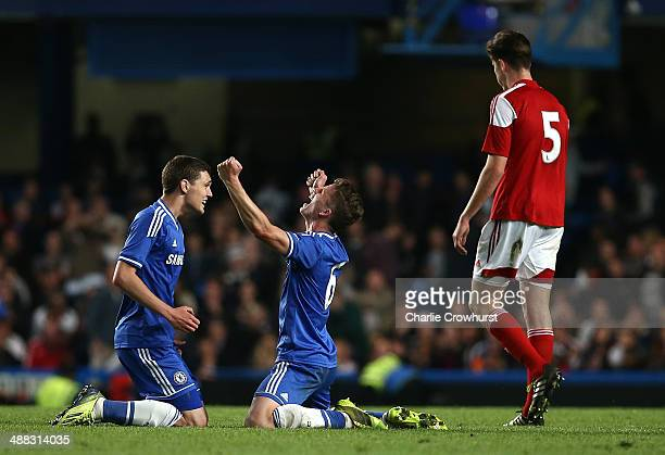 Andreas Christensen of Chelsea celebrates with team mate Jordan Houghton at the final whistle during the FA Youth Cup Final Second Leg match between...