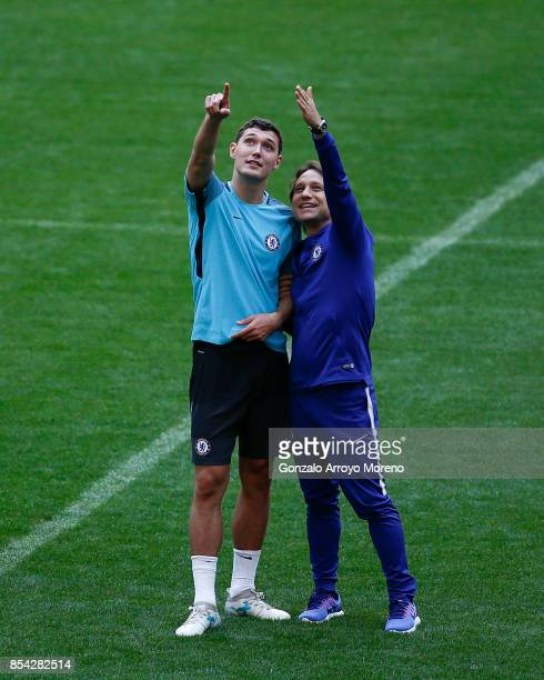 Andreas Christensen of Chelsea FC speaks with assistant coach Gianluca Conte during a training session on the eve of the UEFA Champions League Group...